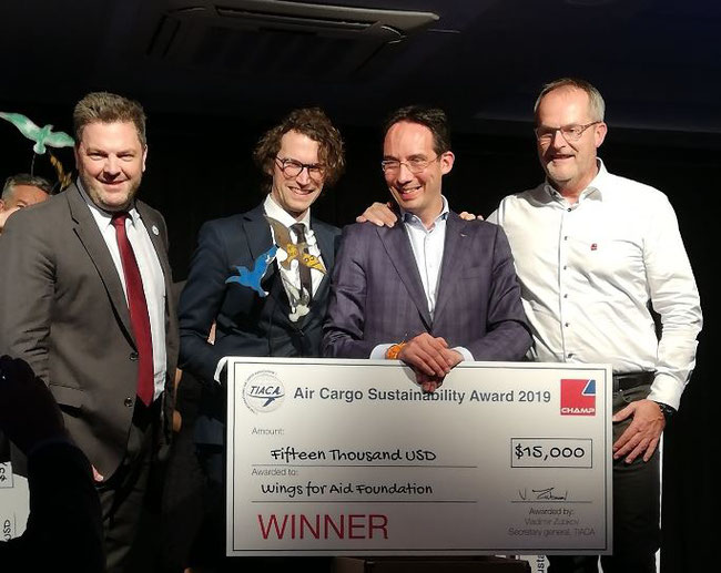 From l to r: Steven Polmans (TIACA), Alexis Roseillier (Wings for Aid), Barry Koperberg (Wings for Aid), Arnaud Lambert (CHAMP) at Sustainability Award ceremony  -  image CFG Gledhill