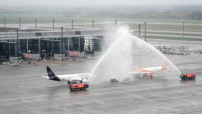 At long last… BER welcomes the first flights with a traditional water shower – photos: company courtesy