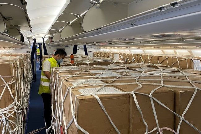 A lot of manpower is needed for loading / unloading freight jammed in 'preighter' cabins – courtesy SZX