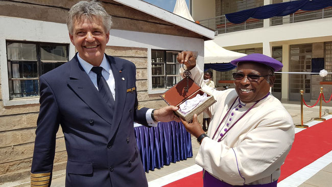 LH Cargo Captain Fokko Doyen hands over the school key and the responsibility for the facility to Bishop Timothy Ranji of the Anglican Church.