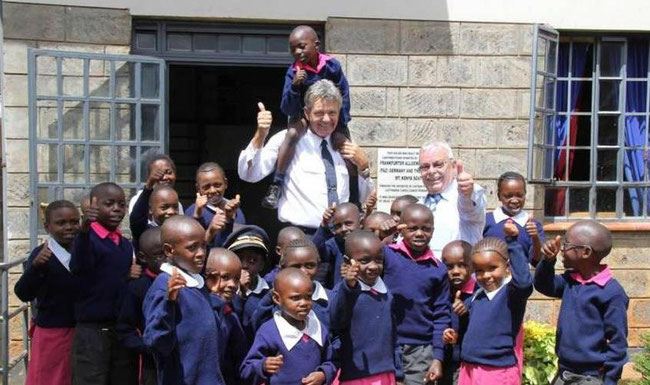 Fokko in his element, surrounded by children from Mother's Mercy Home. Next to him is CHC Chief Financial Officer Gerhard Meyke - photo: CHC
