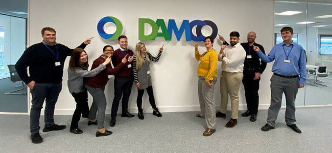 A happy team in their new office home. Image courtesy of DAMCO