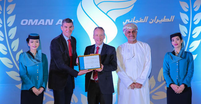 Flanked by Oman Air flight attendants stand (l to r): Paul Starrs, CCO Oman Air  /  Carsten Hernig, MD Jettainer  /  Mohammed Al Musafir, SVP Oman Air Cargo