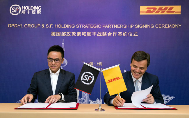 Signing ceremony in Shanghai: Jeffrey Chan, Chief Strategy Officer, S.F. Holding (left) and Pablo Ciano, Executive Vice President, Head of Corporate Development, Deutsche Post DHL Group -  courtesy DP-DHL