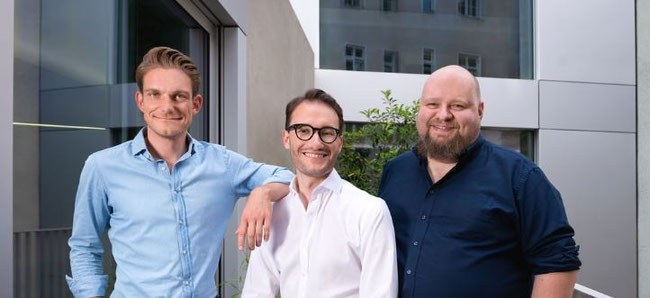 cargo.one's founder team [Oliver T. Neumann (MD), Moritz Claussen (MD) and Mike Rötgers (CTO)] has every reason to smile. Image: cargo.one
