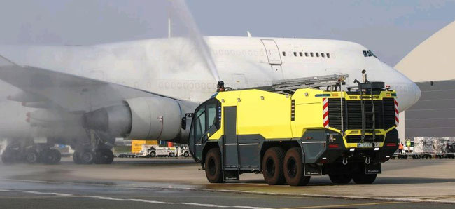Ostende Airport's fire brigade welcomed Hong Yuan's B747F with a water salute  -  courtesy OST