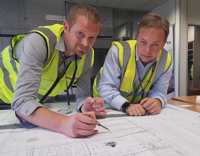 Wouter Vandemaele (left) and Will Dougherty are still putting the final touches on the Pharma Center