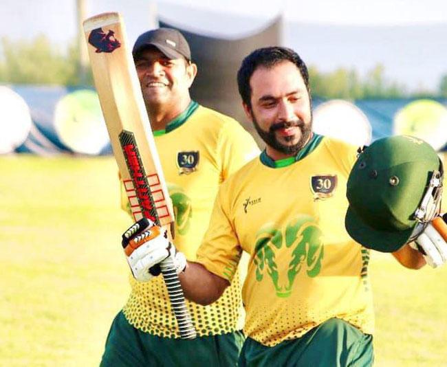 Mehran Khan celebrates his century for Cyprus Moufflons