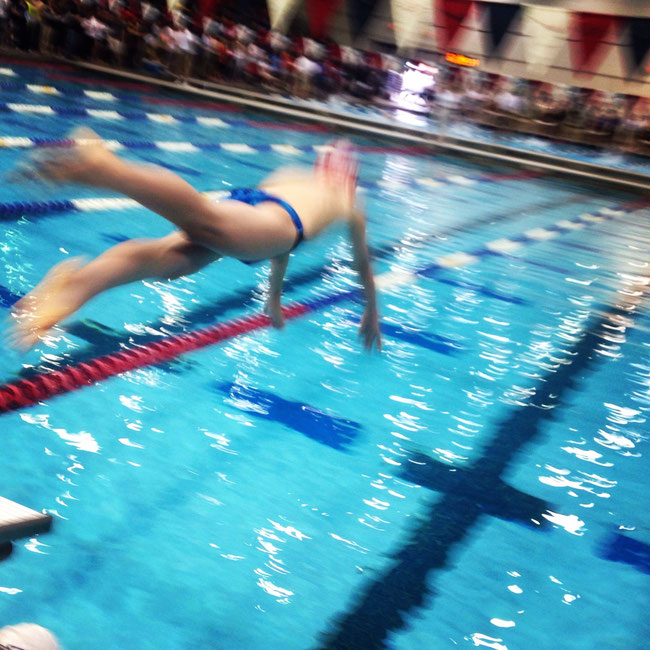 Nolan leaps in during his medal winning freestyle race