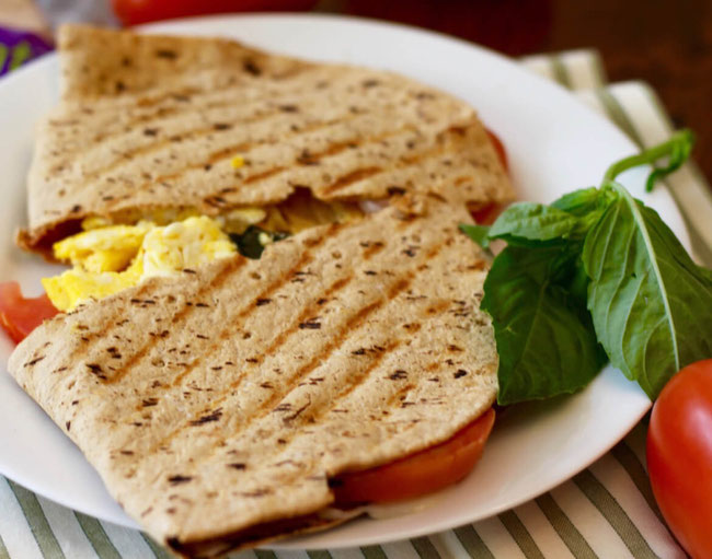 Love flatbread recipes? Make this breakfast sandwich on the Panini press! This Italian breakfast will quickly become one of your fave Panini recipes and sandwich ideas. #breakfastpanini #panini #paninipress #breakfast #flatbreadrecipe #breakfastrecipe