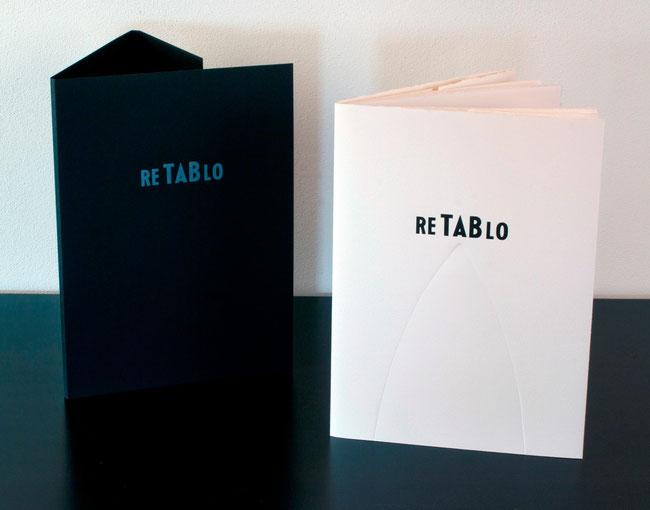 il cofanetto nero stampato in bianco e la copertina tipografica con stampa in nero e a secco