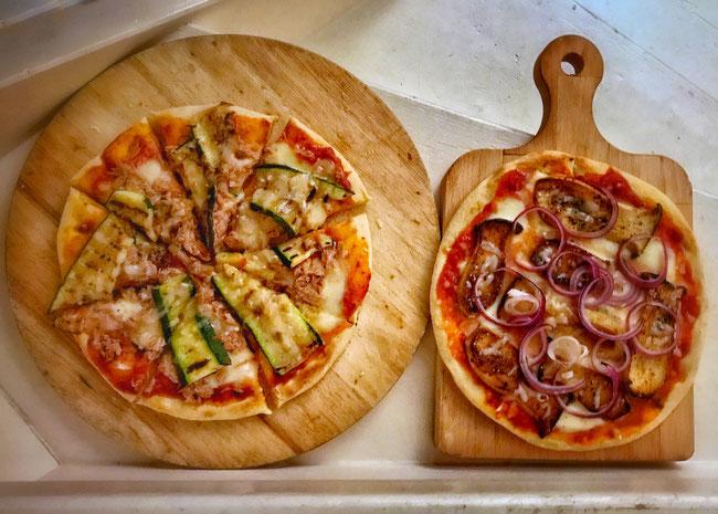 Pizza met tonijn & courgette, pizza met koningsoesterzwam, knoflook en ui