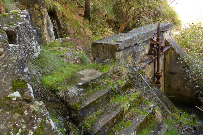 The penstock with the tunnel entrance above