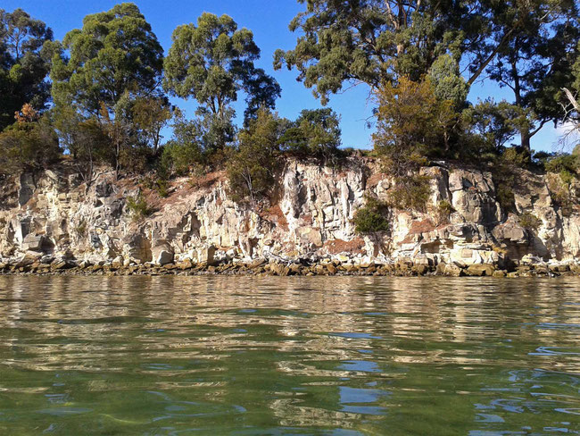 Sandstone cliffs and shallow water
