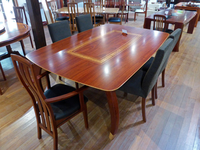 Dining table with burl inlay