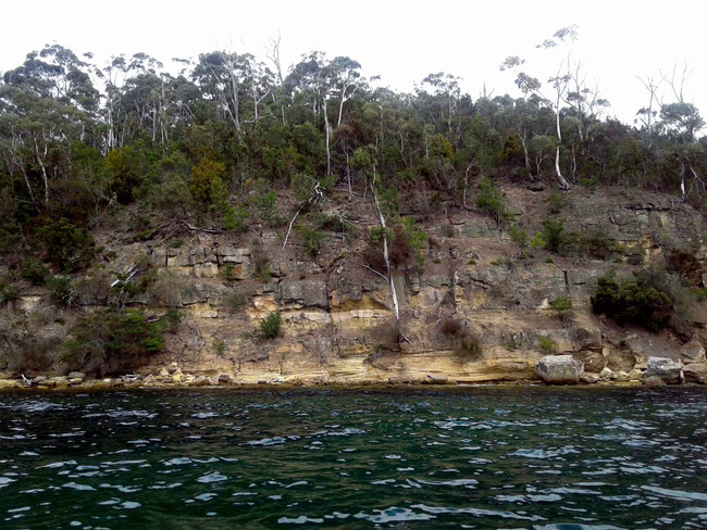 Sandstone cliffs and deep water