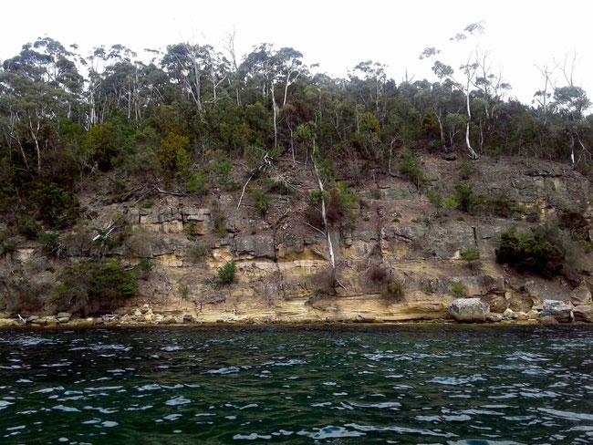 Sandstone cliffs and deep water