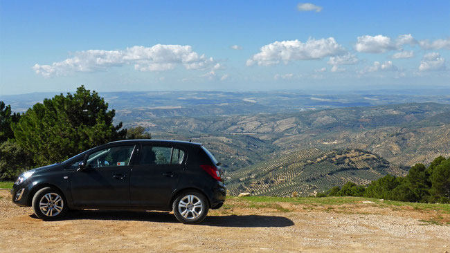 Our hire car, and the view of olive groves  disappearing over the horizon, in Parque Natural Sierras de Cazorla, Segura y las Villas – you can't get here on Public transport!