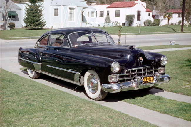 Cadillac 1948 with curved windshield of two halves. On cars Cadillac such windshields have appeared in 1948 model year.