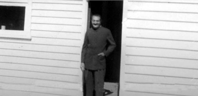 Meher Baba standing in the doorway. Photo courtesy of the Sydney Meher Baba web site.