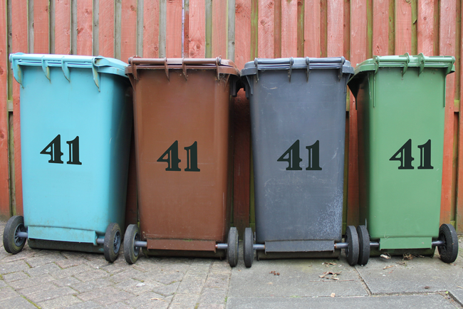 Colourful wheelie bin number stickers in an art cartoon handwritten style.