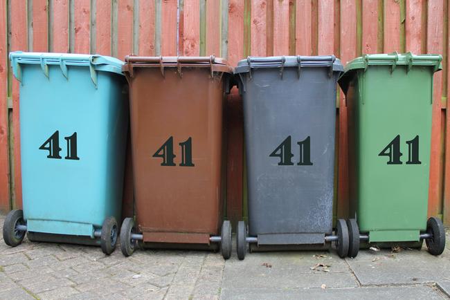 Colourful wheelie bin number stickers in an art cartoon handwritten style.