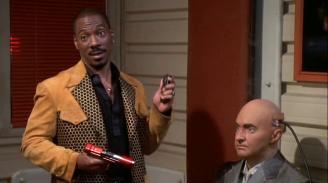 Eddie Murphy & Randy Quaid in The Adventures of Pluto Nash
