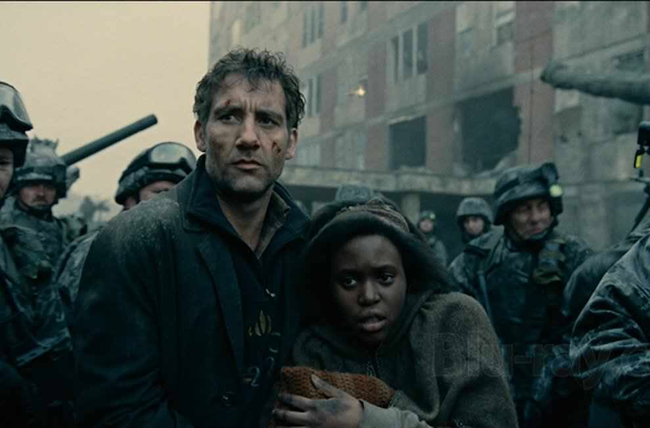Clive Owen & Clare-Hope Ashitey in Children of Men
