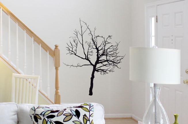 Option 1 of Wish Tree, a black vinyl tree that is very detailed with branches, on a white living room wall.
