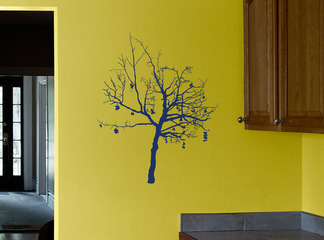Option 3 of Wish Tree, a ultramarine tree with high detail on the branches and boots with shoe laces on a mustard yellow kitchen wall.