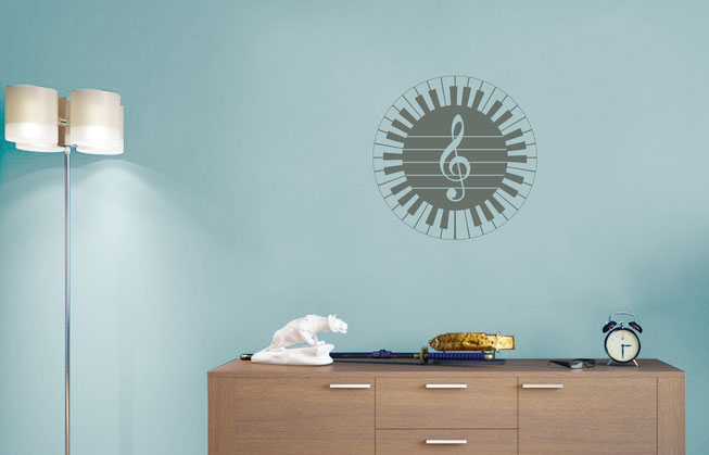 61 keyed piano vinyl wall art decal for music lovers, there is a treble clef in the centre of the  sticker. From www.wallartcompany.co.uk