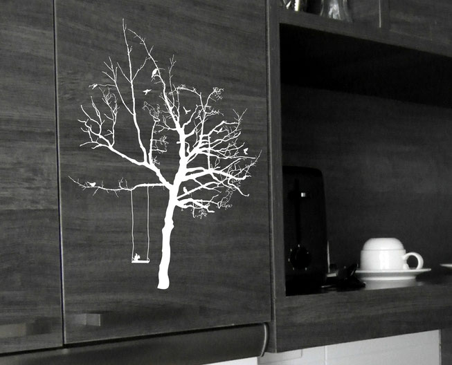 Option 8 Wish Tree, white vinyl tree with birds and a wing on the black cupboard of a kitchen.