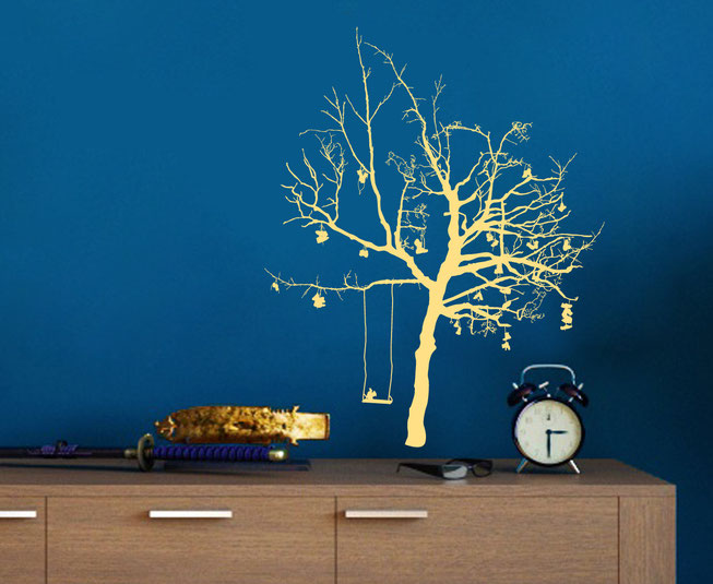 Option 5 Wish Tree, cream coloured detailed branched tree with shoes and a swing with a squirrel on a blue wall in a living room.