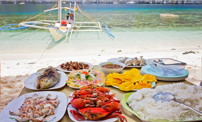 Why not all-day island hopping in the Philippines? With this lunch on a pristine beach? And for $13??