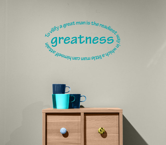 To vilify a great man is the readiest way in which a little man can himself attain greatness vinyl sticker Edgar Allen Poe quote for walls. This vinyl is in lemon yellow on a lilac wall.