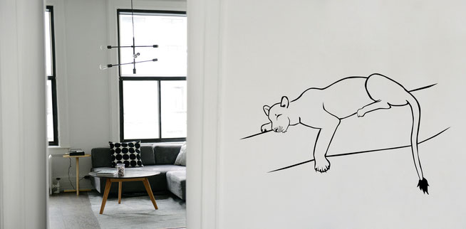 Black vinyl sticker Big Cat sleeping Lioness on a white wall. Easy to apply and comes in a various selection of colours to suit any room for home decoration.