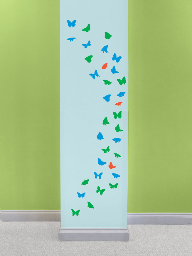 A flock of butterflies with detailed wings pictured in a bedroom. These are a versitle wall art design and the butterflies can be placed almost anywhere. A collection of different sizes will add a new element to a wall. Great for school books.