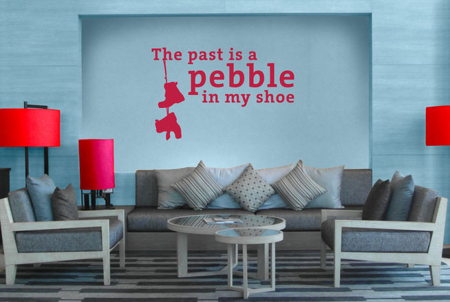 The past is a pebble in my shoe Edgar Allen Poe quote vinyl sticker. Hanging boots are attached from the 'h' in the adding a unique take on the quote. Easy to apply to walls and comes in many colours at wallartcompany.co.uk