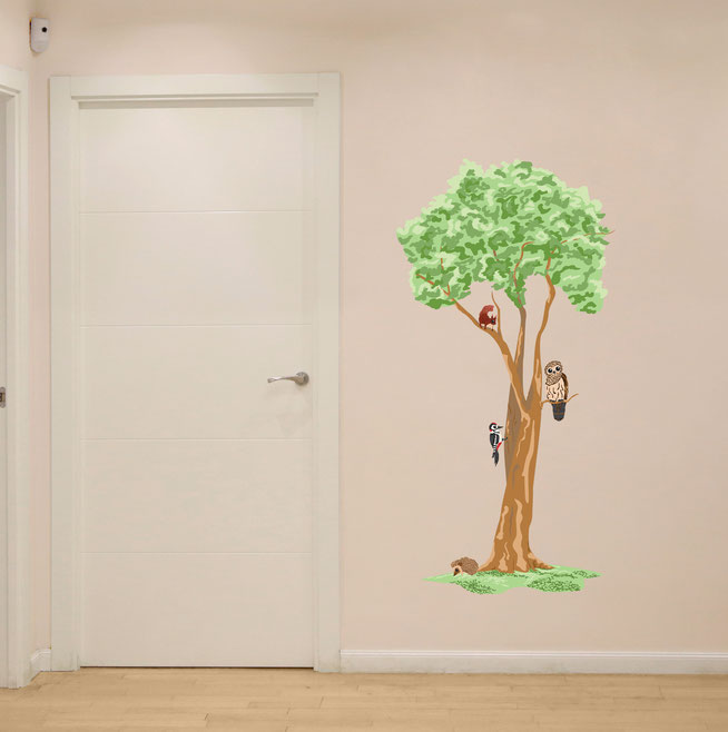 Woodland tree with woodland animals wall art. The woodland animals are a squirrel, owl, woodpecker and hedgehog. From www.wallartcompany.co.uk