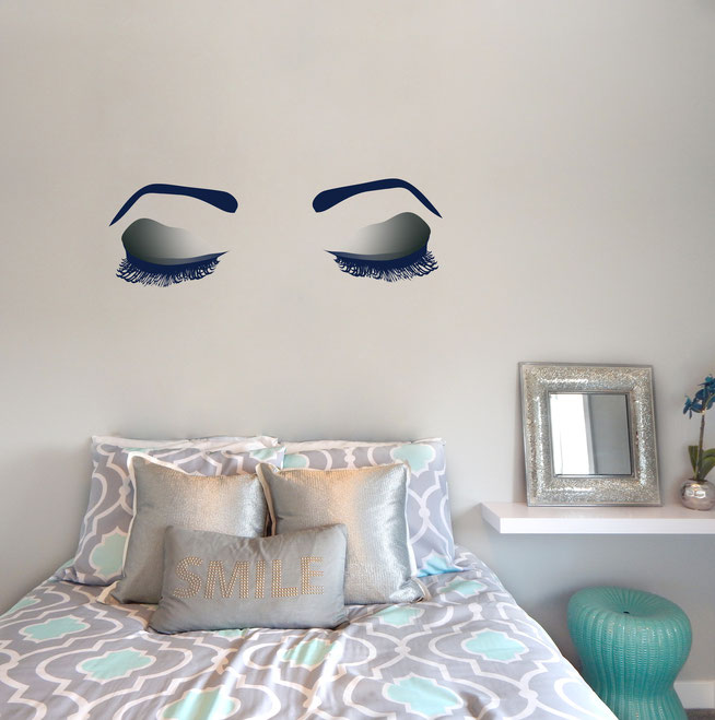 Women's Eyes on a bedroom wall in a blue vinyl and printed on clear black eye shadow wall art sticker.