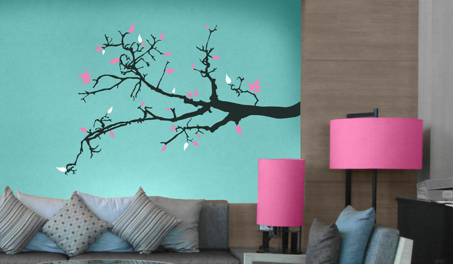 Spring Branch gray colour vinyl with pink and white leaves on a green wall in a living room. Beautiful wall art  from www.wallartcompany.co.uk