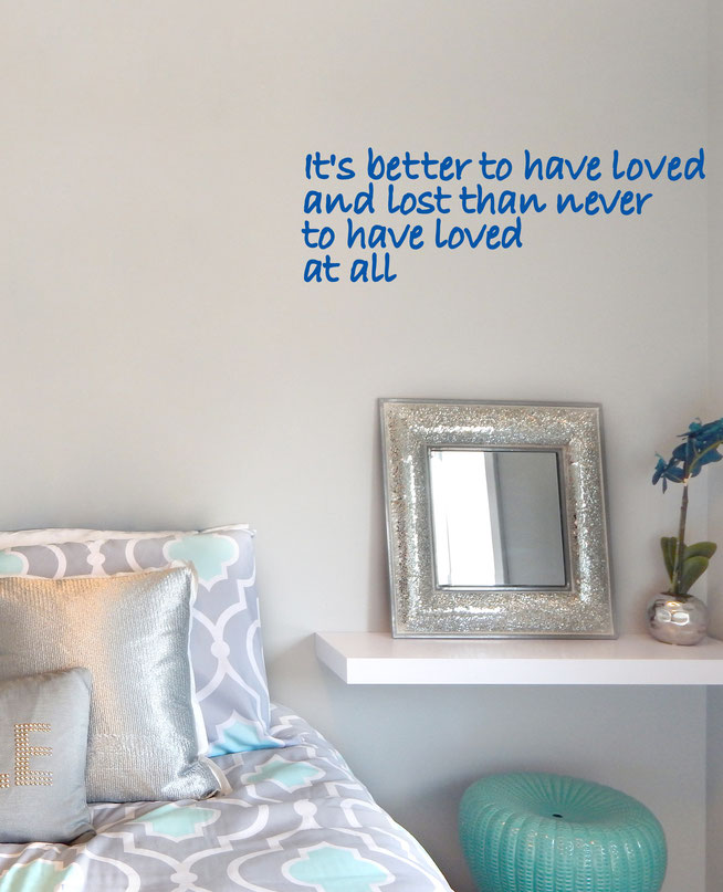 It's Better To Have Loved And Lost Than Never To Have Loved At All, vinyl quote paragraph on a teens bedroom wall.