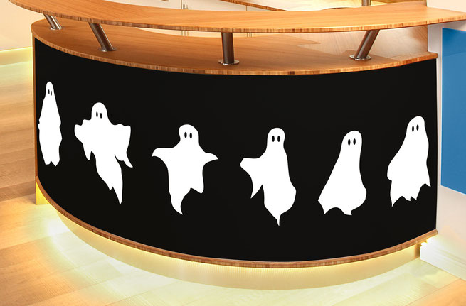 Ghost wall stickers on the bottom of a kitchen counter, Halloween themed spooky sheet ghosts for walls and windows.