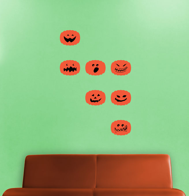 Vinyl sticker Pumpkins with spooky and scary faces for decorating at Halloween.