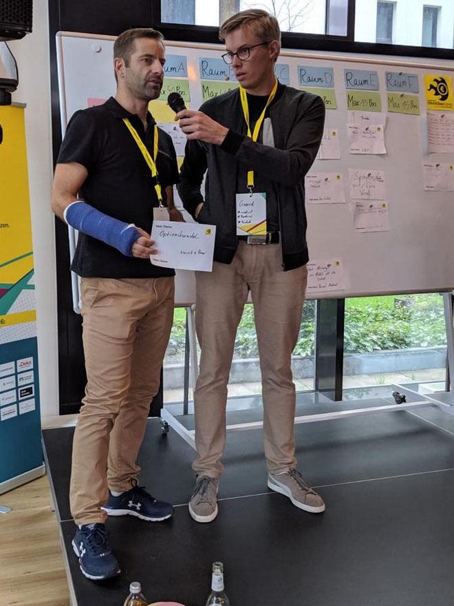 Comdirect Finanzbarcamp 2019, freaky finance, Geer Lukaßen, 2 Männer auf der Bühne, Themenvorschlag, Optionshandel
