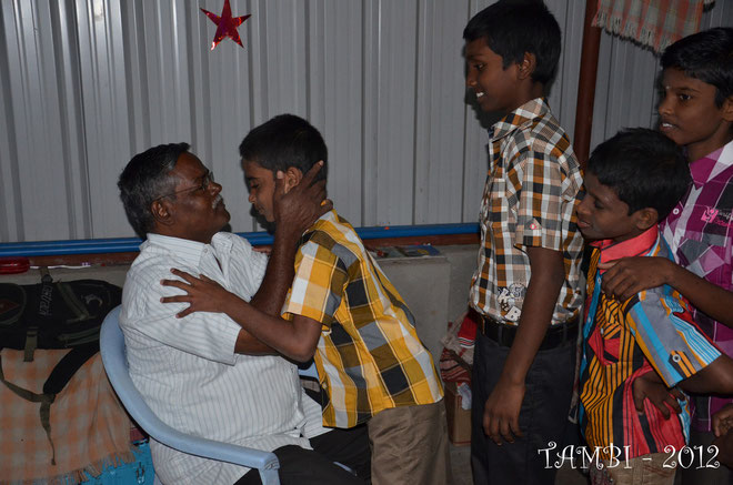 Each child received a christmas kiss from Mr Aruldass - December 2012