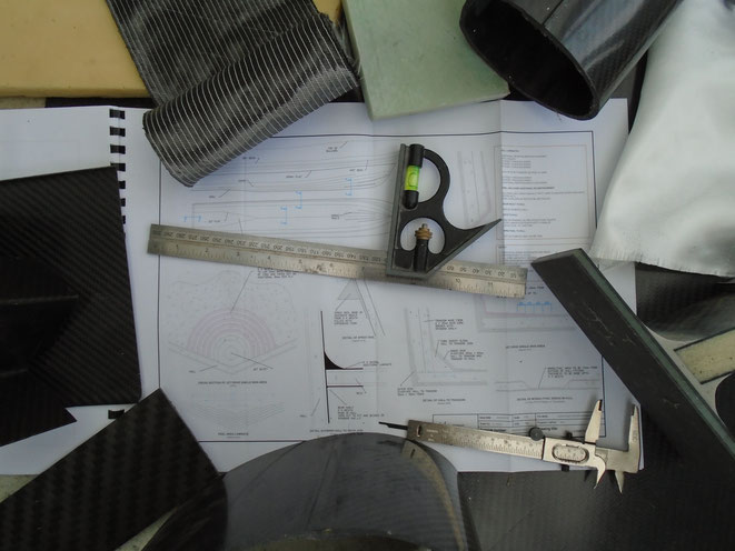 Carbon fibre, fiberglass, SAN core composite materials, technical construction drawings and accurate measuring tools.