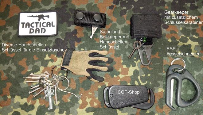 Diverse Handschellenschlüssel und die Fesselschneider von ESP und dem Cop-Shop.