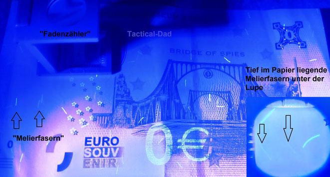 """Melierfasern sind ein tolles Sicherheitsmerkmal, zu deren Prüfung man eine Lupe bzw. einen Fadenzähler haben sollte. Hier auf dem """"0 Euro Schein"""" vom Spionagemuseum Berlin, der ebenfalls die meisten Sicherheitsmerkmale aufweist."""