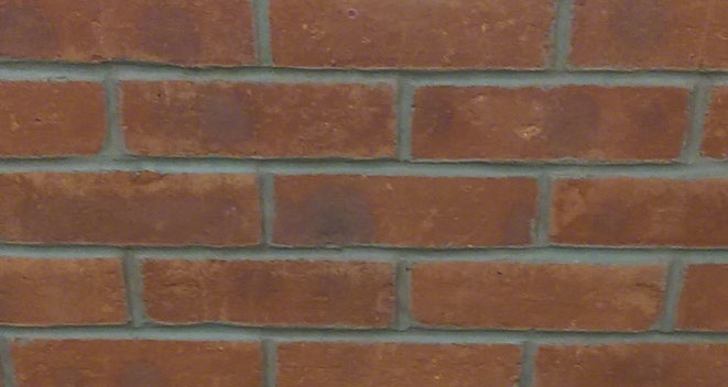 Mortared Brick Slips in Tracking System